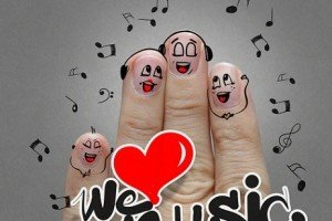 the happy finger family holding we love music